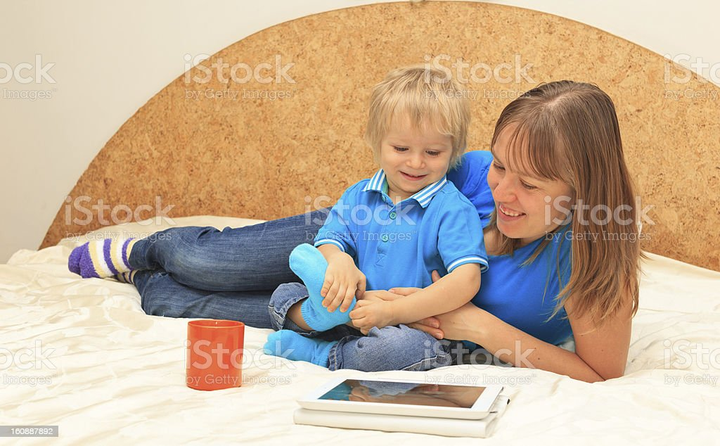 Family with touch pad at home royalty-free stock photo