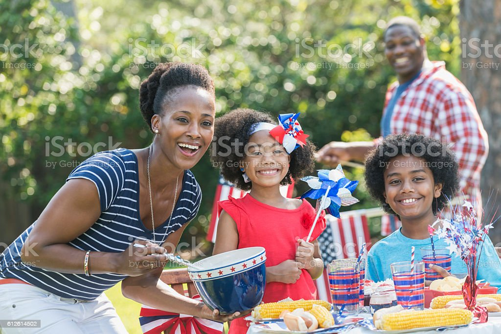 Family with two children celebrating 4th of July stock photo