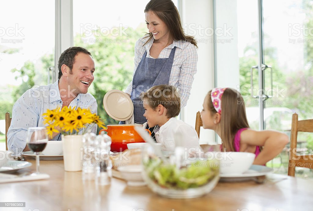 Family with two children (8-11) having lunch at dining table royalty-free stock photo