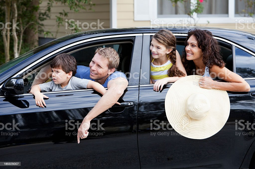 Family with two children in car stock photo