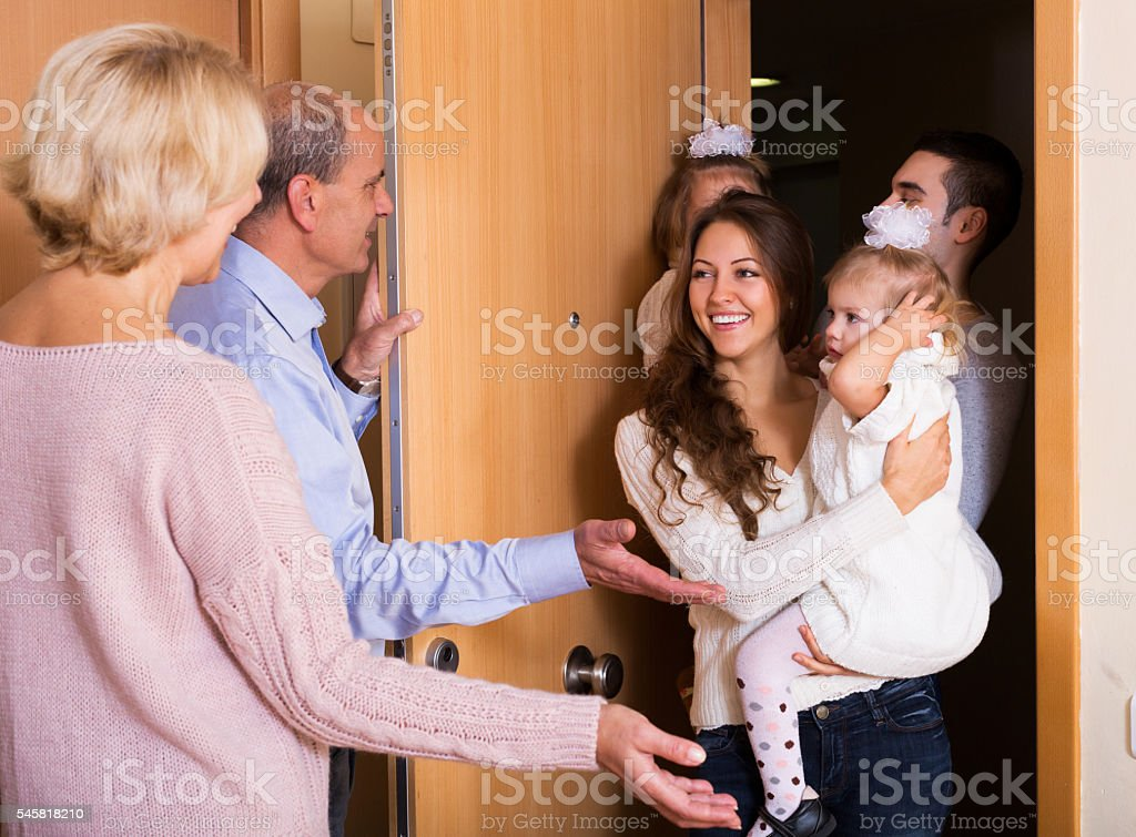 family with two daughters visiting grand parents stock photo