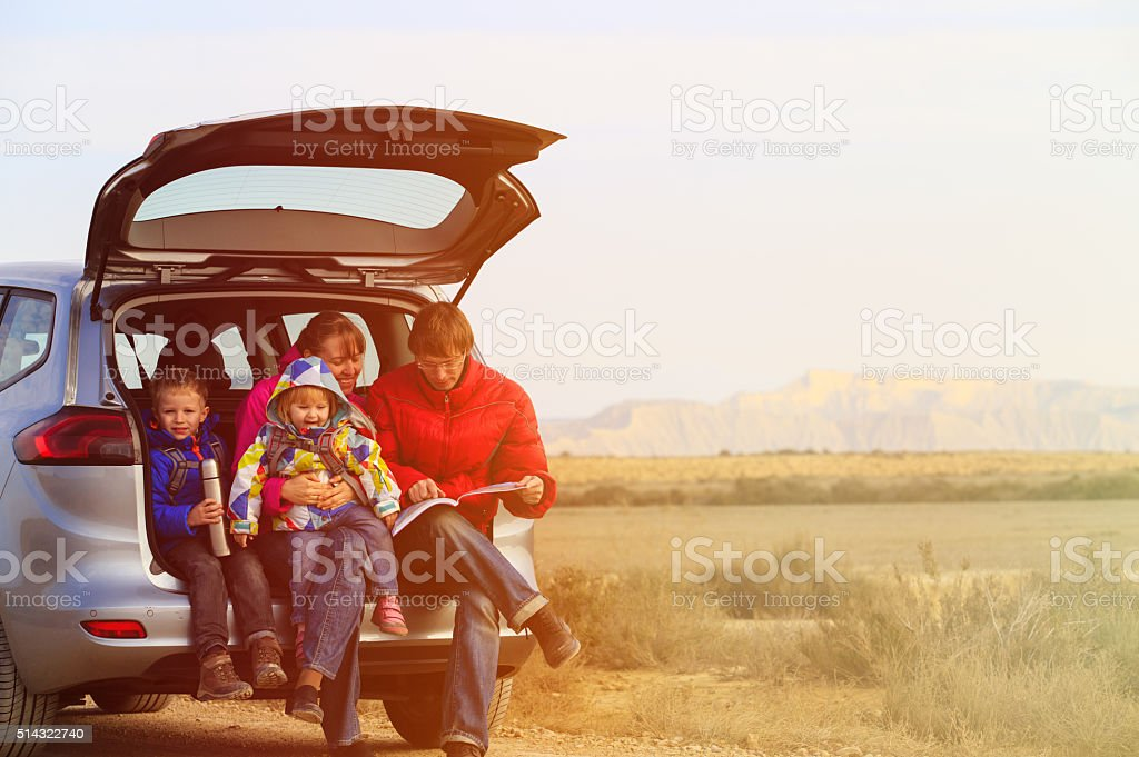 family with two kids travel by car in mountains stock photo