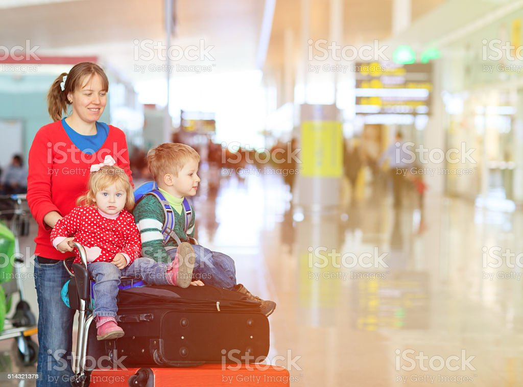 family with two kids travel in the airport stock photo