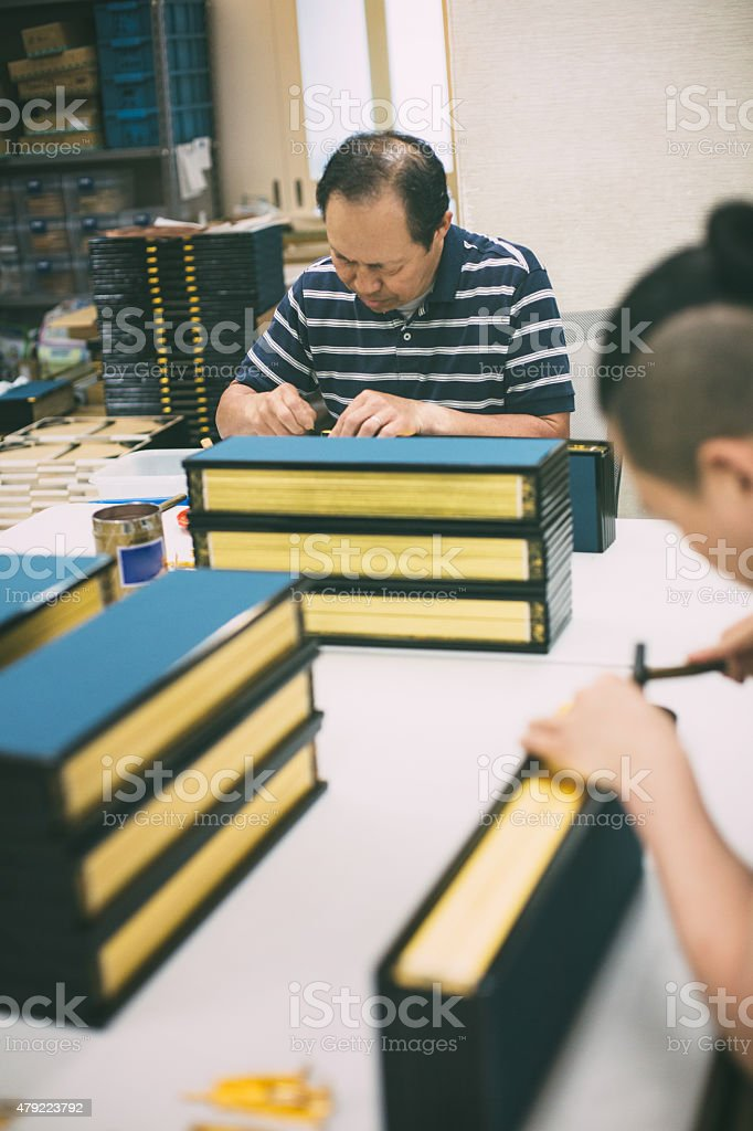 Family work on the wooden craft boxes stock photo