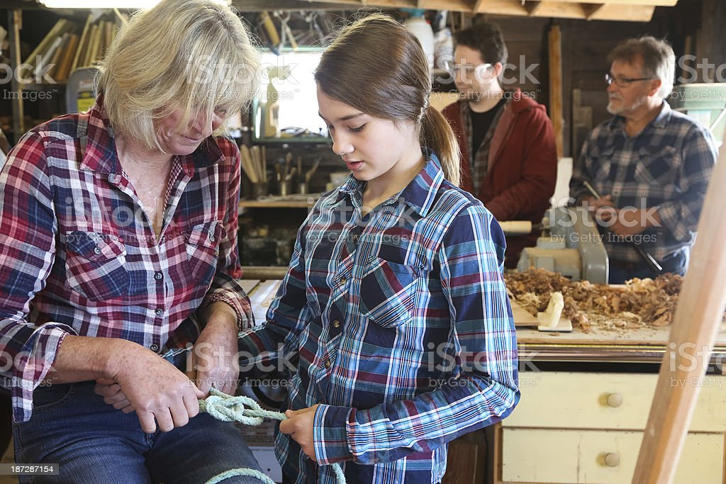 Family Working Together in Wood Shop stock photo