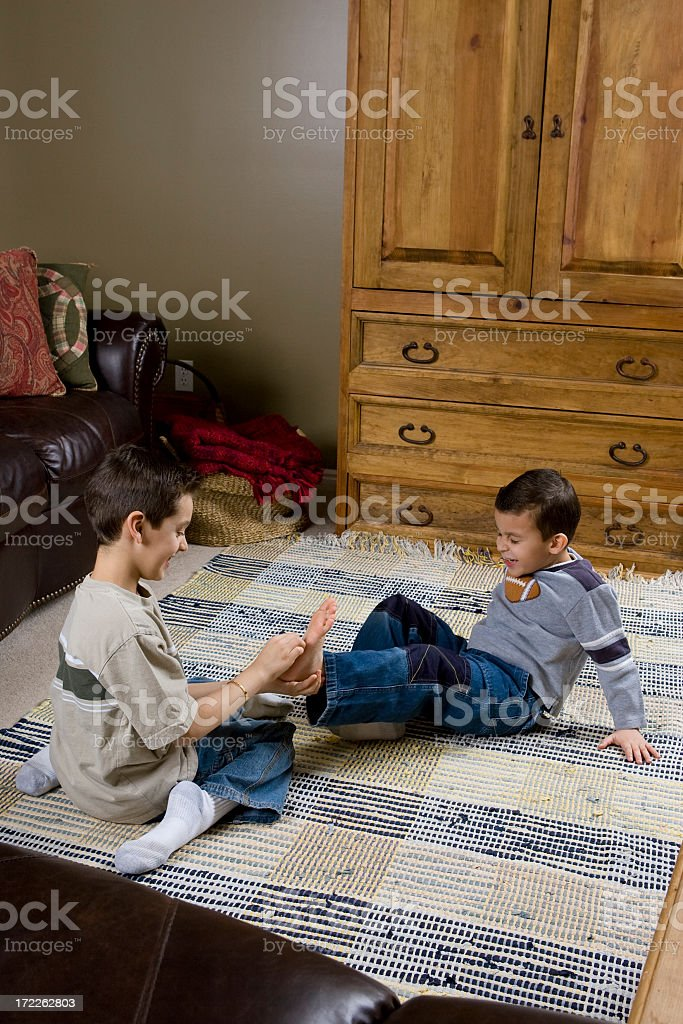 Family-Brothers Tickling Feet royalty-free stock photo