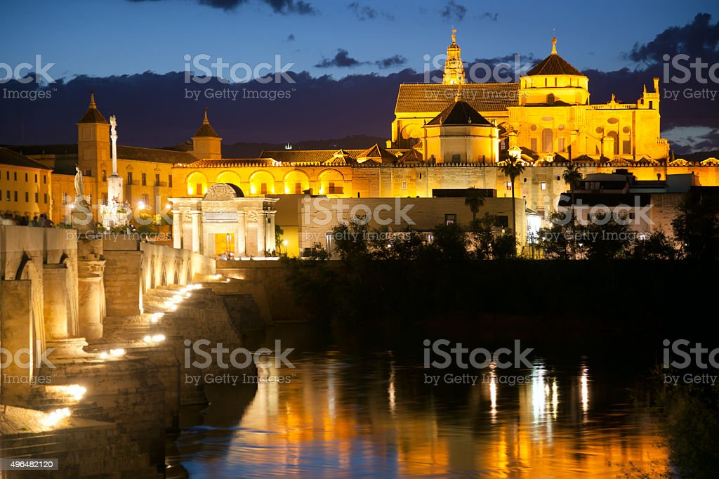 Famos Mosque (Mezquita) and  Roman Bridge at night, Spain, Euro stock photo