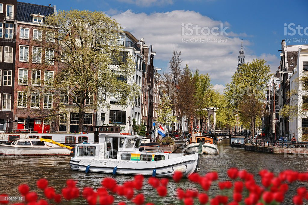 Famous Amsterdam with boats on canal in downtown, Holland stock photo