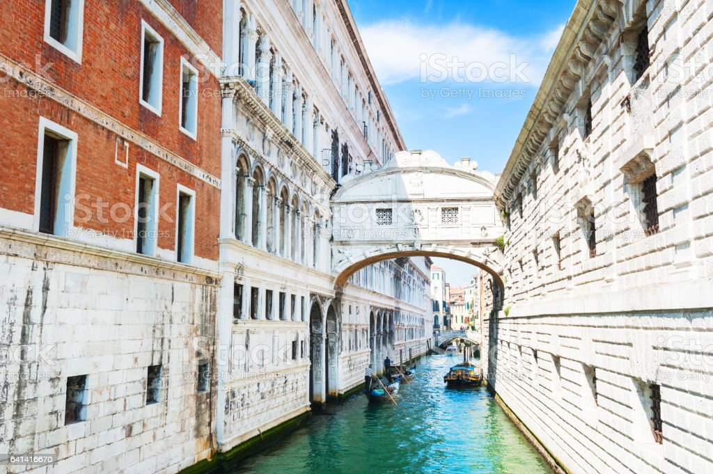 Famous Bridge of Sighs and scenic canal in Venice, Italy stock photo