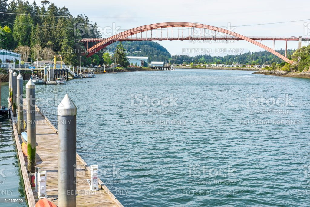 Famous bridge with boats and waterfront waterway stock photo