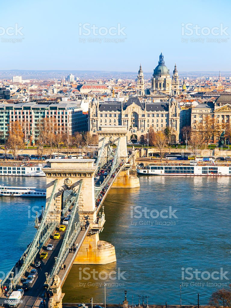 Famous Chain Bridge over Danube River, Gresham Palace and Saint stock photo