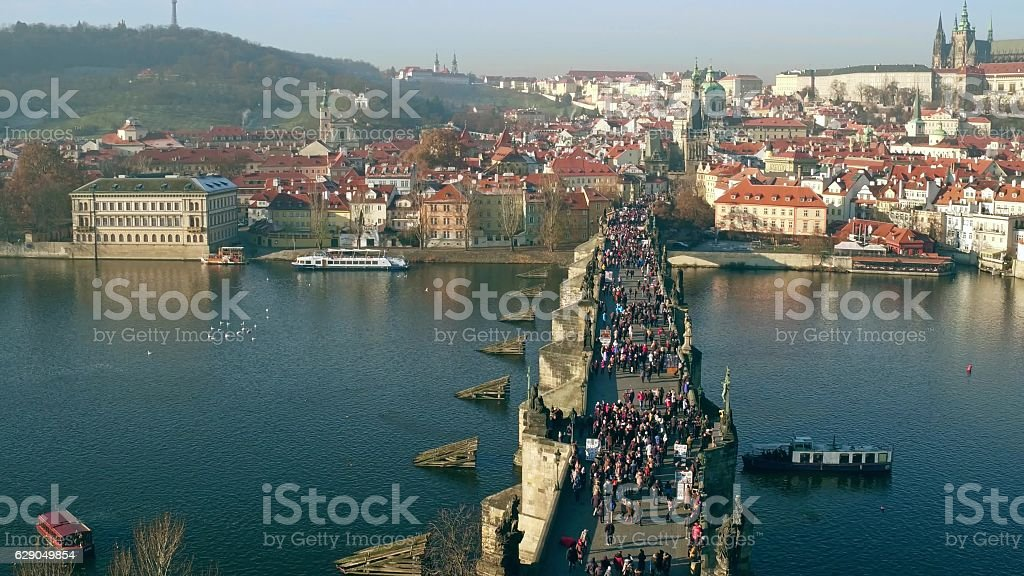 Famous Charles bridge and distant Prague castle on a sunny stock photo