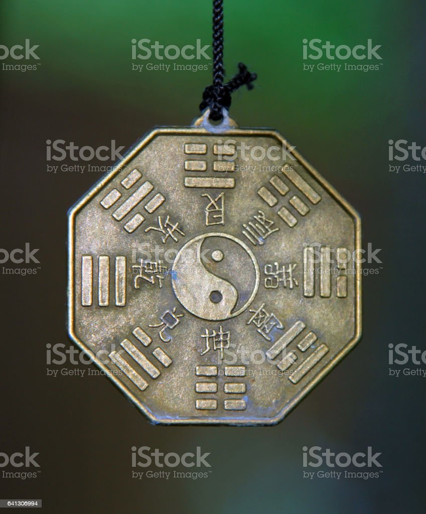 Famous chinese sign Yin and Yang surrounded by Trigrams and hieroglyphs stock photo