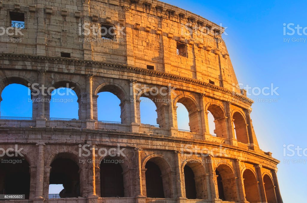 Famous coliseum of Rome at early sunset stock photo