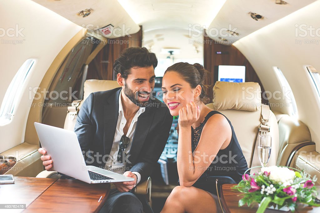 Famous couple in private jet airplane stock photo