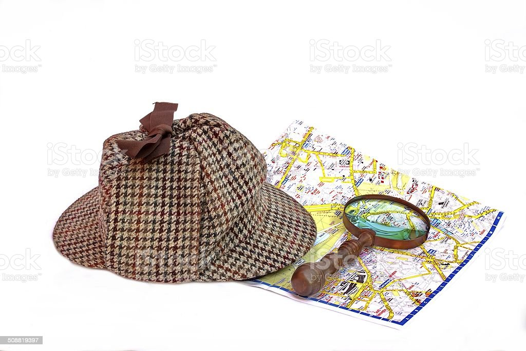 Famous English Detective Hat, Magnifier and London Map stock photo