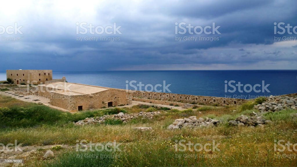 Famous fortress in the town of Rethymno on the island of Crete with beautiful views of the sea in cloudy bright weather stock photo