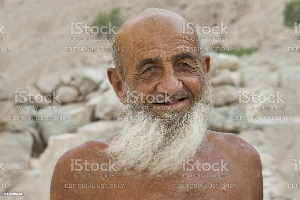 Famous goatherd living near Diba, Musandam (Oman) stock photo