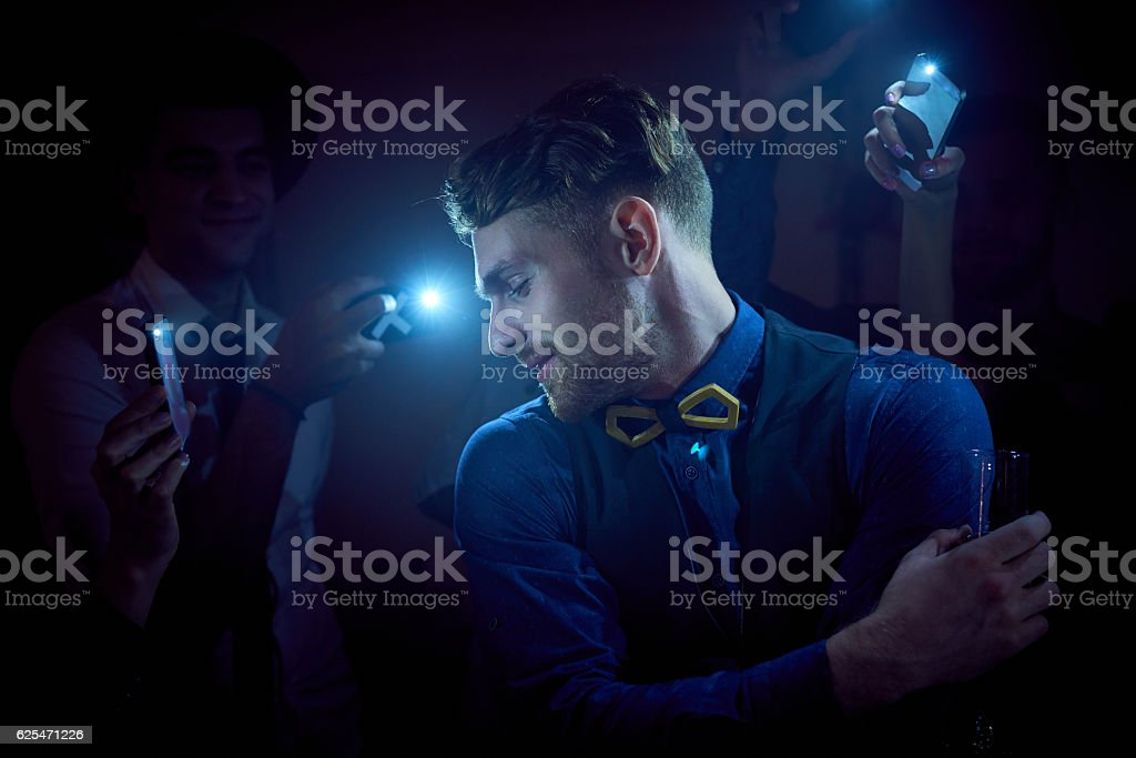 Famous guy at party stock photo