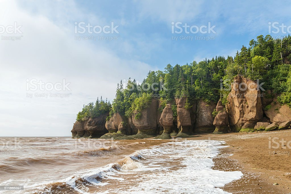 Famous Hopewell Rocks flowerpot formations at low tide stock photo