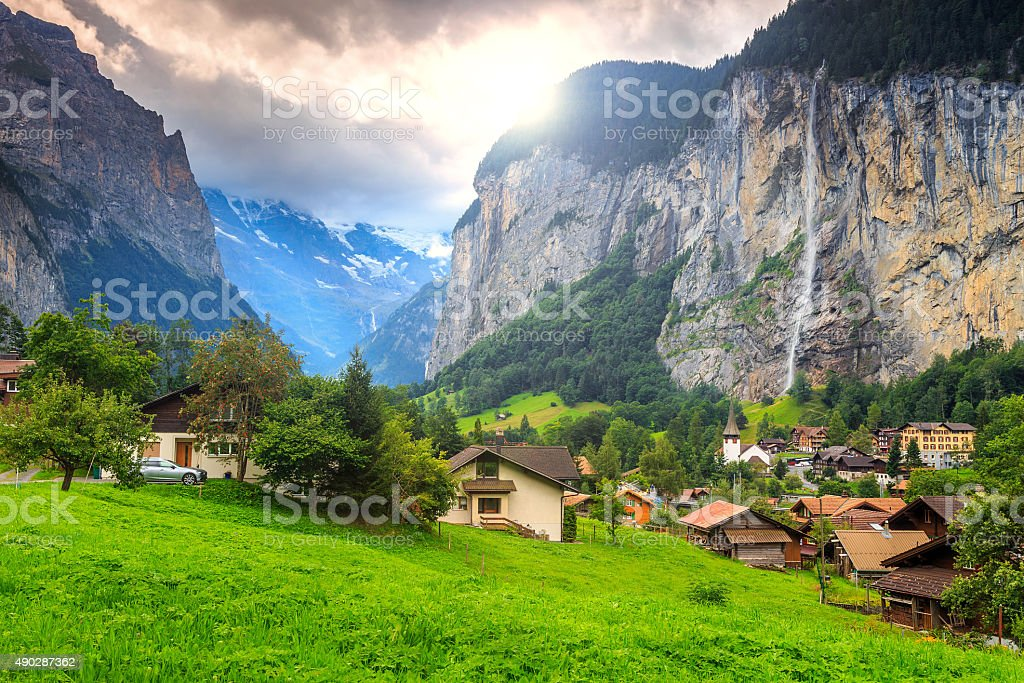 Famous Lauterbrunnen town and Staubbach waterfall,Bernese Oberland,Switzerland,Europe stock photo