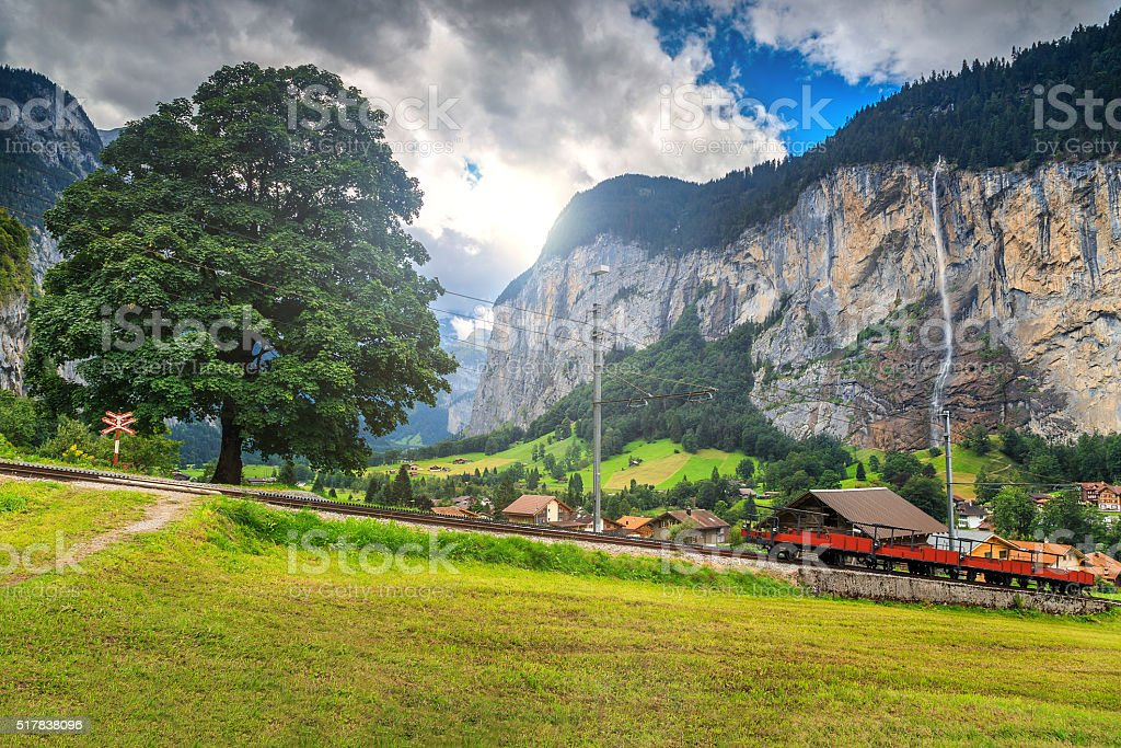 Famous Lauterbrunnen town and Staubbach waterfall,Bernese Oberland,Switzerland,Europe stock photo