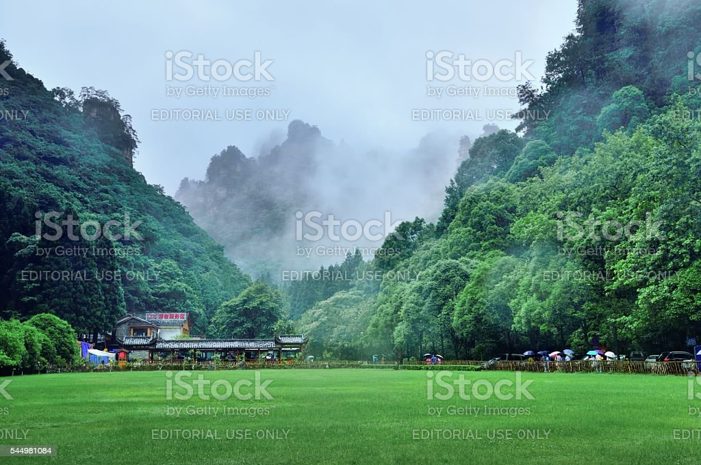 Famous mountains and visitor center in misty rain stock photo