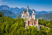 Famous Neuschwanstein Castle with scenic mountain landscape near