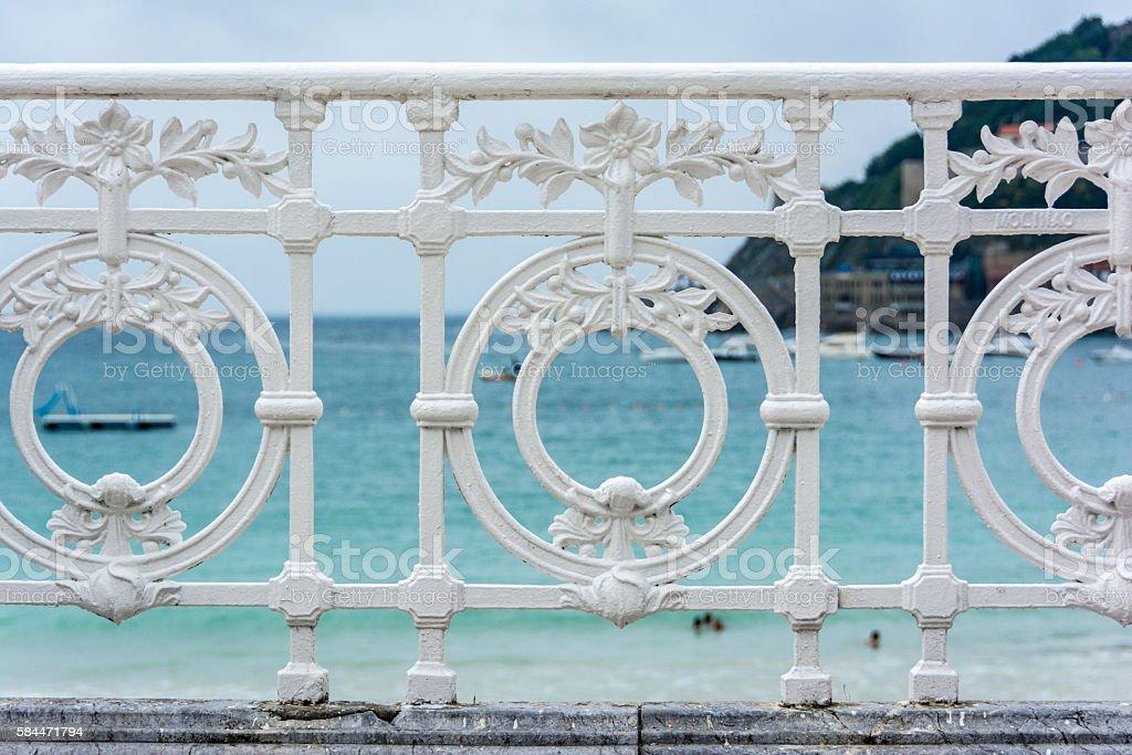 Famous ornamental iron fence in La Concha beach, San Sebastian stock photo