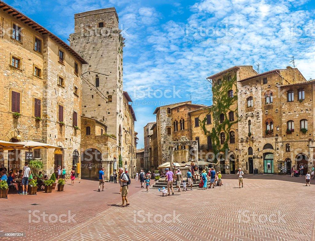 Famous Piazza della Cisterna in historic San Gimignano, Tuscany, Italy stock photo