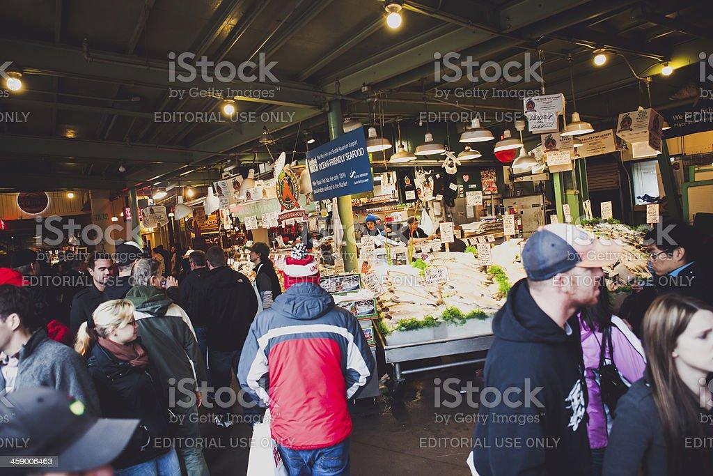\'Seattle, USA - November 11, 2012: A large crowd of tourists flood...