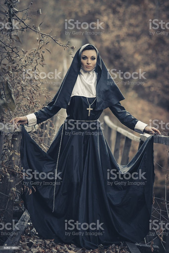 Famous, self-assured, strong, powerful, domineering nun stock photo