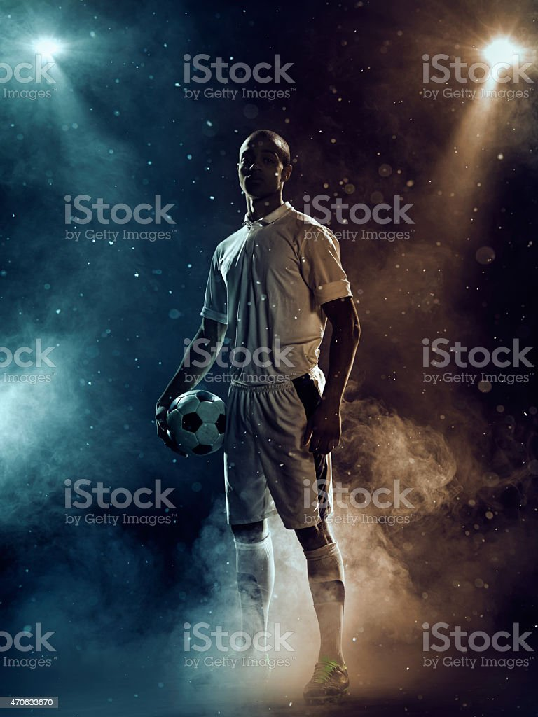 Famous soccer player under highlights stock photo