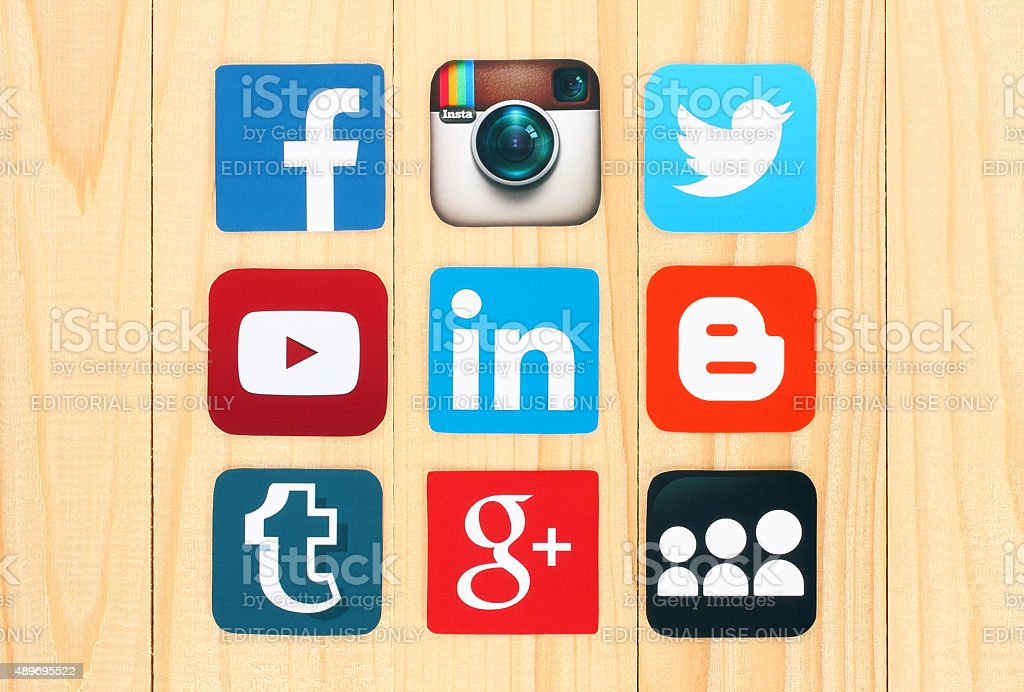Famous social media icons on wooden background stock photo