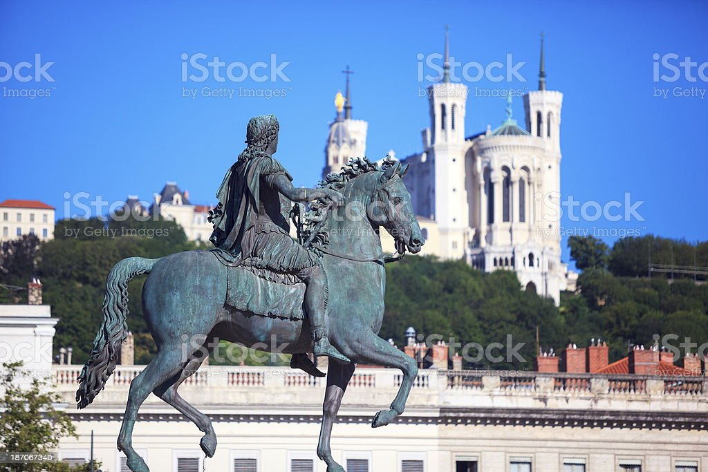 Famous statue of Louis XIV and Basilique stock photo