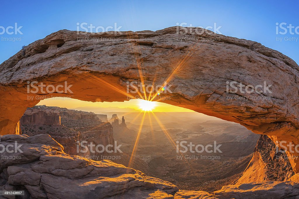 Famous sunrise at Mesa Arch stock photo
