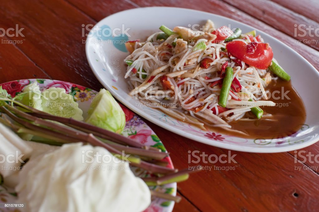 Famous Thai food, papaya salad serve with vegetables or what we called 'Somtum' in Thai stock photo