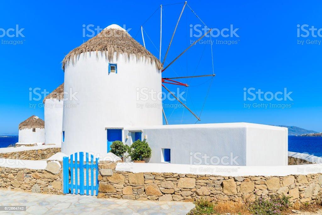 Famous traditional windmills on island of Mykonos, Cyclades, Greece stock photo