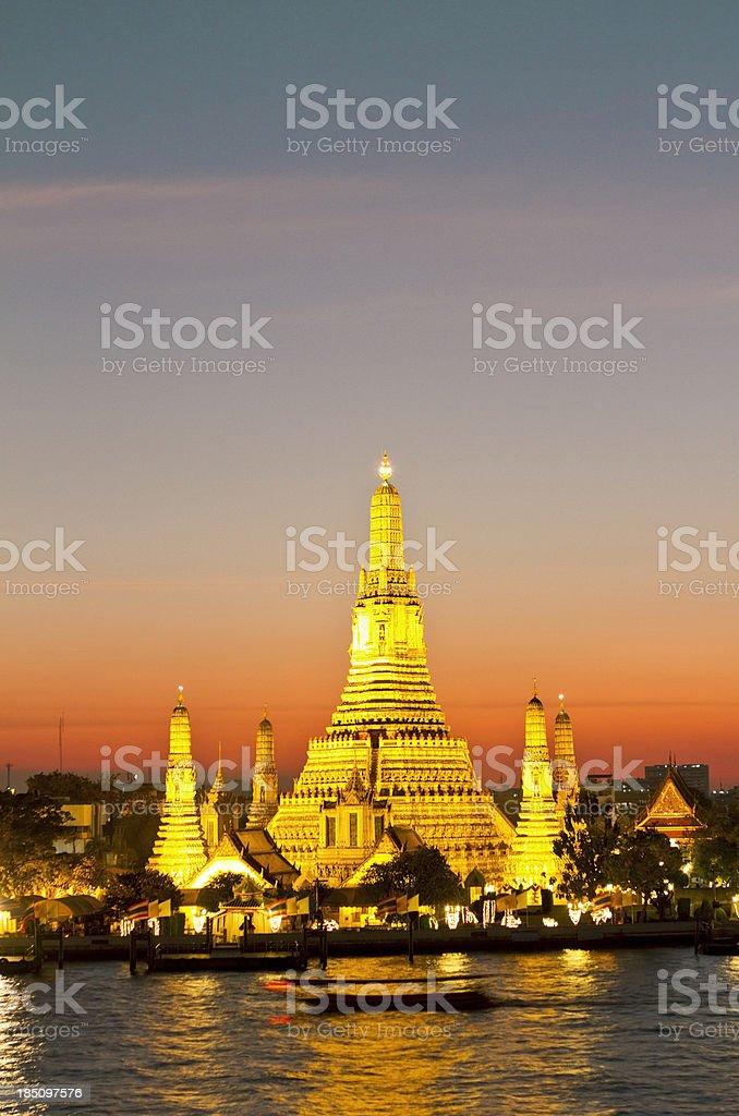 Famous Wat Arun temple in Bangkok at dusk royalty-free stock photo