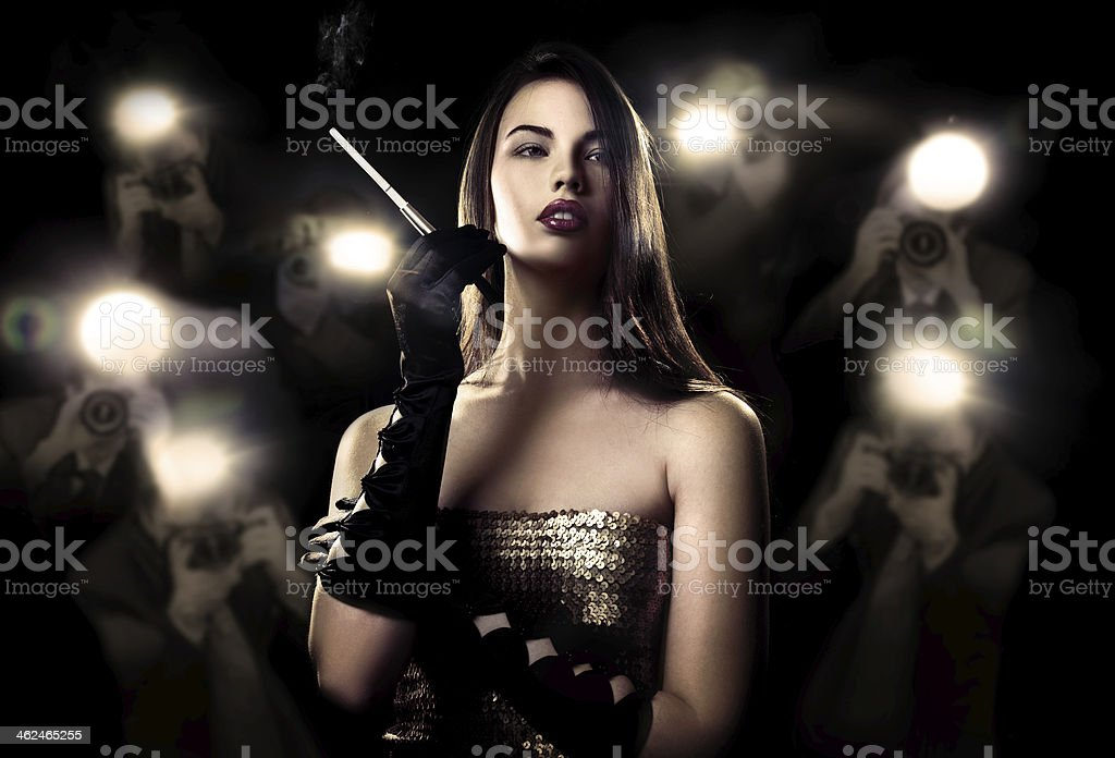 Famous woman and paparazzi stock photo