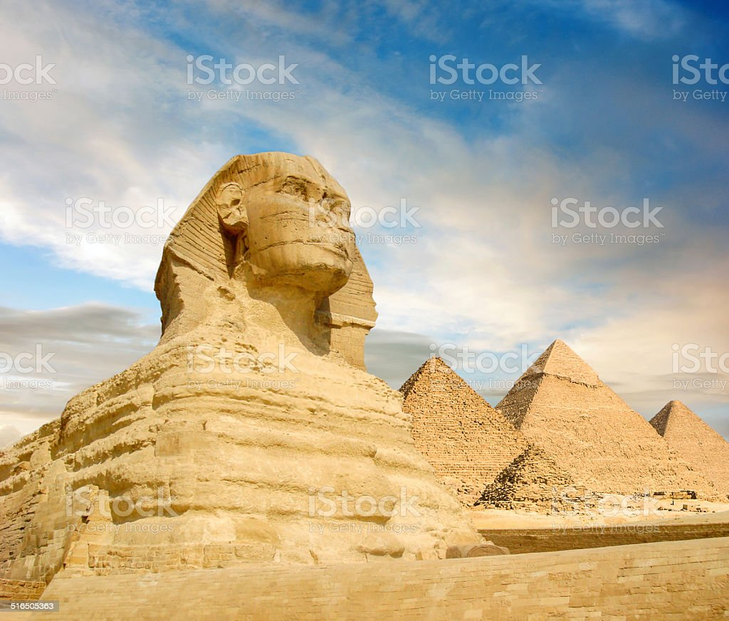 Famouse Sphinx and the great pyramids in Giza Valley stock photo