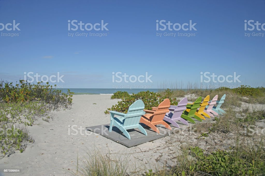 Fan Chairs on Wood Deck Lined-up in Row stock photo