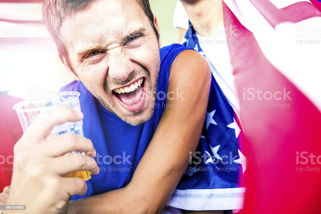 USA fan drinking beer in the stadium royalty-free stock photo