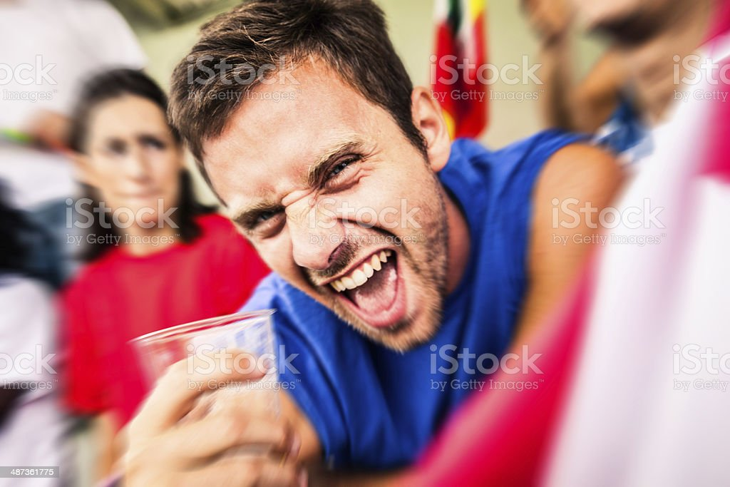 USA fan drinking beer in the stadium stock photo