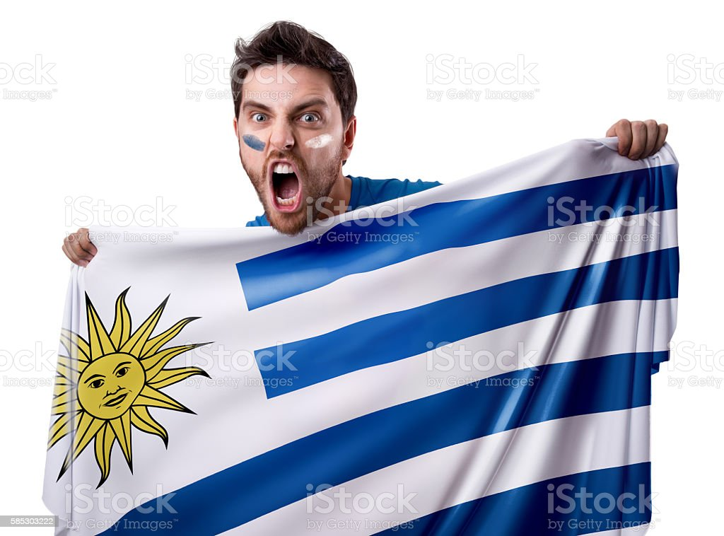 Fan holding the flag of Uruguay stock photo