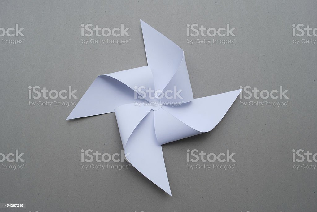 A fan made out of pale blue origami paper stock photo