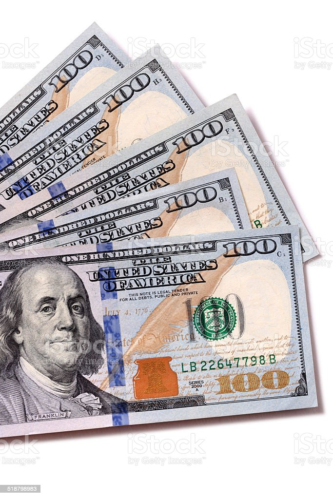Fan of $100 bills isolated stock photo