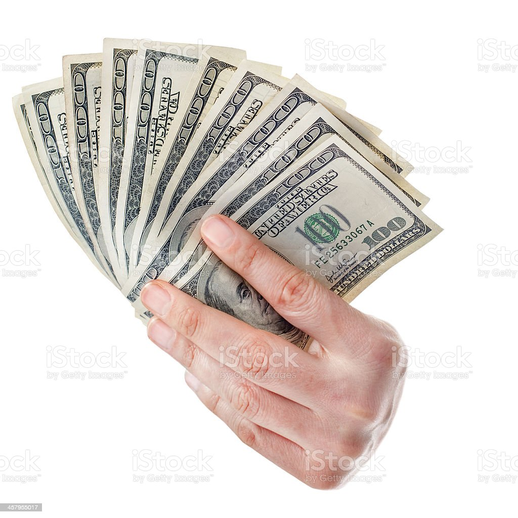 Fan of money dollars in hand isolated on white stock photo