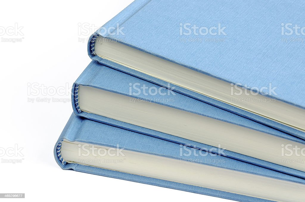 Fan of three blue books on a white background royalty-free stock photo