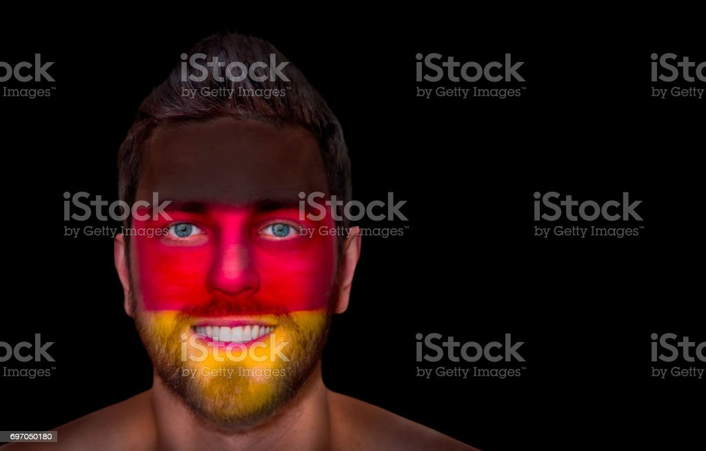 Fan / Sport Player painted his face with German flag stock photo